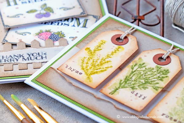 Hero Arts Monthly Card Kit garden theme. Seed packets and fence die. Colored with Kuretake Zig markers. Project by Wanda Guess