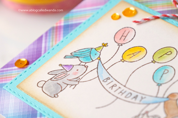Handmade birthday card with watercolor pencils, balloons, sequins