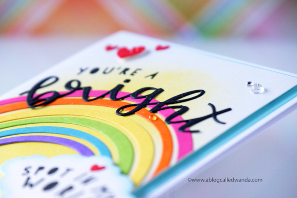 Distress Ink rainbow and background. Bright spot card