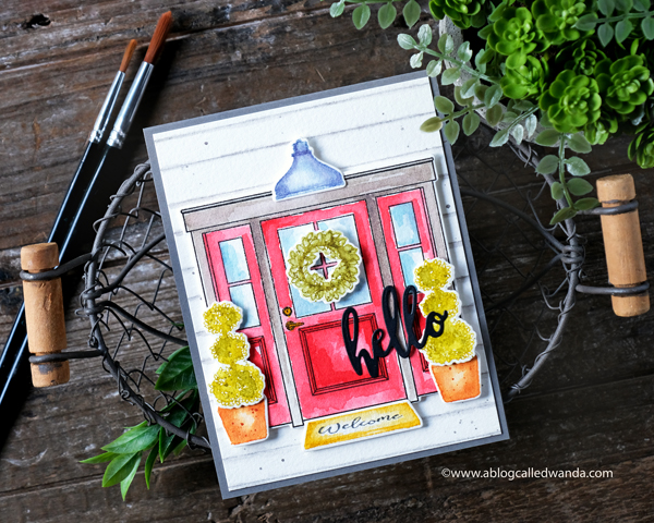 WPlus9 stamps and dies. New Home stamp set. Watercolor with Distress Inks. No Line watercoloring. Hello die, new house card. Wanda Guess