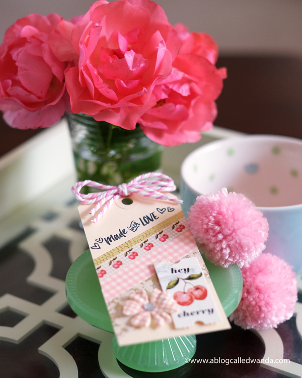 gift tag and pom poms