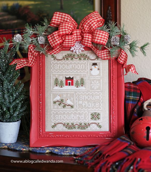 Country Cottage Needleworks Snow Sampler. Finished and framed by Wanda Guess