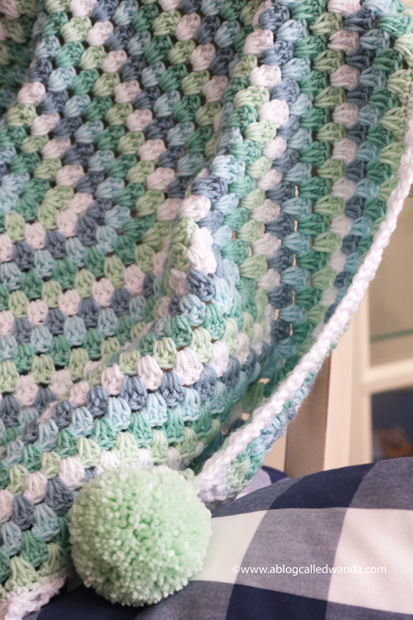Crochet Granny Square Blanket. Baby Blanket. Crochet ideas. Pastel colors. X border with pom poms. Wanda Guess