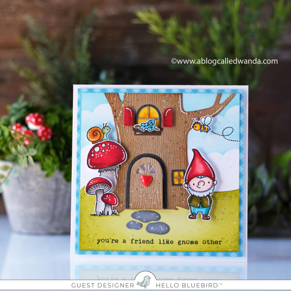 Hello Bluebird stamps. Treehouse die, next door gnome stamp set, garden party stamp set, bee happy stamp set. Copic Markers, CLoud stencil, DIstress ink blending, handmade card by Wanda Guess
