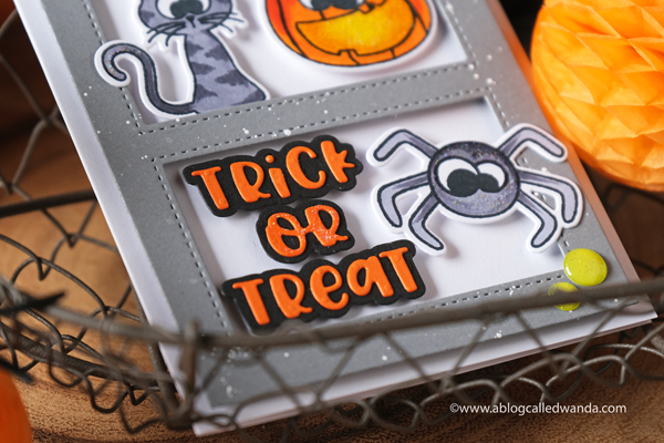 Photoplay Paper Say it with Stamps and dies. Halloween Card. Slimline card ideas. Copic coloring Halloween. Rectangle cut outs. Fun DIY Halloween. Wanda Guess
