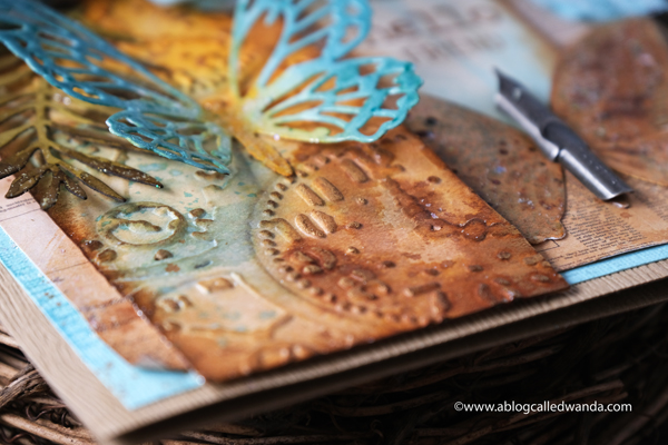 Tim Holtz, Sizzix, Ideaology, Stampers Anonymous, Speckled Egg Distress Ink, TIm Holtz Techniques. Butterfly card. Butterfly dies, Tropical Thinlets, Glorious Bouquet stamps. Distress Ink vintage card. Wanda Guess