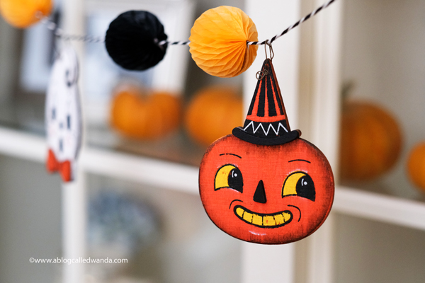 halloween decor, halloween decorations, tiered tray ideas, halloween fun, festive, decorations, party, garland, honeycomb balls, vintage halloween, wanda guess
