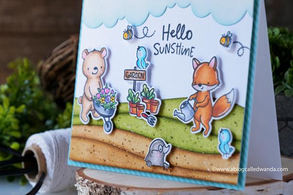 hello bluebird stamps, hello bluebird new release, hello bluebird bloom and grow, word buddies, card layout, copics, garden card, card ideas, stamping, koalas, distress ink blending, ocean waves die, wanda guess, a blog called wanda