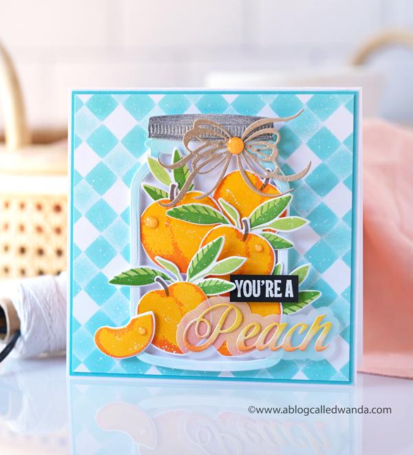 The Greetery, The Greetery Blog, The Greetery Inspiration Friday, TGIF, Wanda Guess, The Greetery Just Peachy, Peachy Keen, Stencils, Square Dance Stencils, The Greetery Jumbo Jar, The Greetery fit to be tied bow dies, mason jar card ideas, Summery Card, Vellum, Gingham, Peaches stamps and dies, A blog called wanda